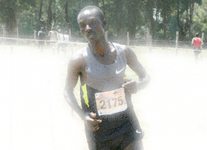 Kenneth Kipkemoi on his way to win the 22nd Discovery Cross Country, Eldoret, January 27, 2013.
